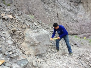 Noe Castanon getting the boulder ready to push over the edge